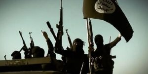 """An image grab taken from a propaganda video released on March 17, 2014 by the Islamic State of Iraq and the Levant (ISIL)'s al-Furqan Media allegedly shows ISIL fighters raising their weapons as they stand on a vehicle mounted with the trademark Jihadists flag at an undisclosed location in the Anbar province. The jihadist Islamic State of Iraq and the Levant group has spearheaded a major offensive that began on June 9, 2014 and has since overrun all of Iraq's northern Nineveh province. AFP PHOTO / HO / AL-FURQAN MEDIA === RESTRICTED TO EDITORIAL USE - MANDATORY CREDIT """"AFP PHOTO / HO / AL-FURQAN MEDIA"""" - NO MARKETING NO ADVERTISING CAMPAIGNS - DISTRIBUTED AS A SERVICE TO CLIENTS FROM ALTERNATIVE SOURCES, AFP IS NOT RESPONSIBLE FOR ANY DIGITAL ALTERATIONS TO THE PICTURE'S EDITORIAL CONTENT, DATE AND LOCATION WHICH CANNOT BE INDEPENDENTLY VERIFIED ==="""